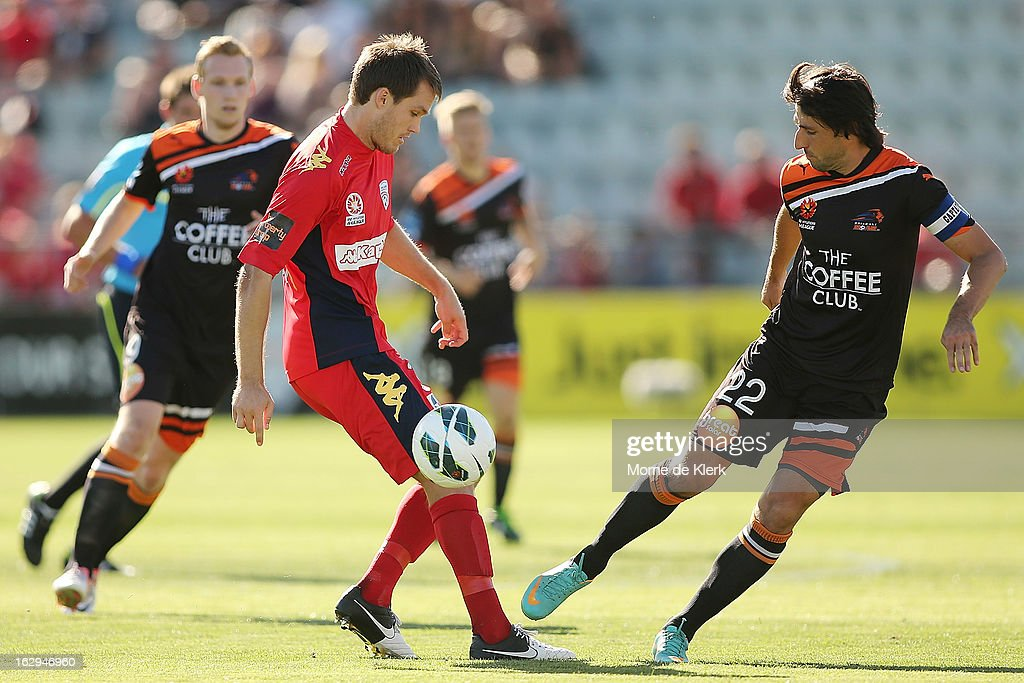 <a gi-track='captionPersonalityLinkClicked' href=/galleries/search?phrase=Thomas+Broich&family=editorial&specificpeople=676225 ng-click='$event.stopPropagation()'>Thomas Broich</a> (R) of Brisbane wins the ball from Nigel Boogaard of Adelaide during the round 23 A-League match between Adelaide United and the Brisbane Roar at Hindmarsh Stadium on March 2, 2013 in Adelaide, Australia.