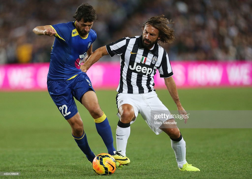 Thomas Broich of the All Stars and Andrea Pirlo of Juventus compete for the ball during the match between the A-League All Stars and Juventus at ANZ Stadium on August 10, 2014 in Sydney, Australia.