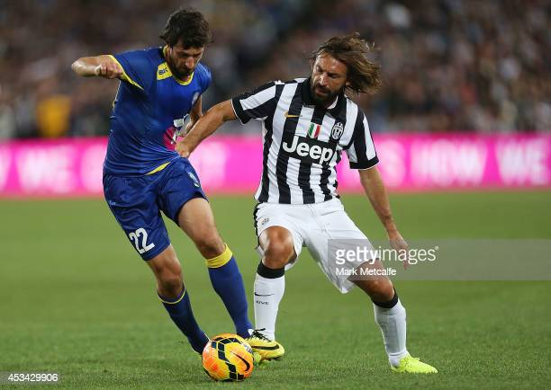 Thomas Broich of the All Stars and Andrea Pirlo of Juventus compete for the ball during the match between the ALeague All Stars and Juventus at ANZ...