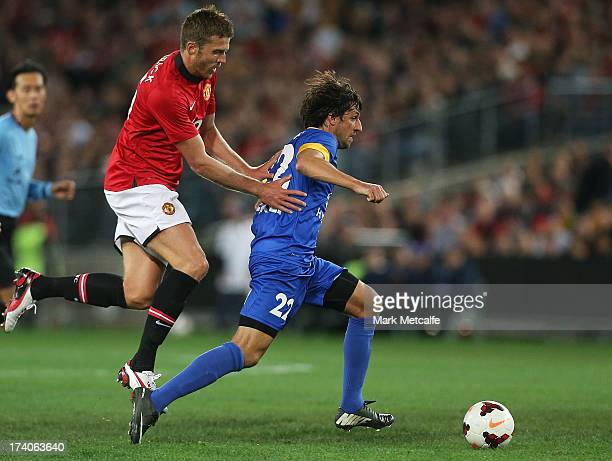 Thomas Broich of the AllStars is challenged by Michael Carrick of Manchester United during the match between the ALeague AllStars and Manchester...