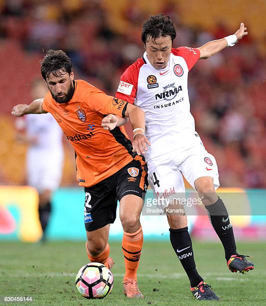 Thomas Broich of the Roar and Jumpei Kusukami of the Wanderers challenge for the ball during the round 22 ALeague match between Brisbane Roar and...