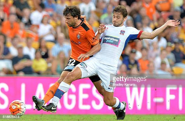 Thomas Broich of the Roar and Mateo Poljak of the Jets compete for the ball during the round 26 ALeague match between the Brisbane Roar and the...