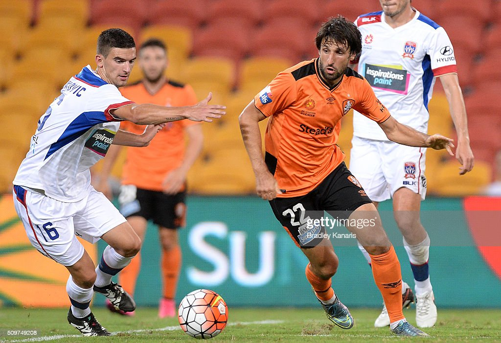 <a gi-track='captionPersonalityLinkClicked' href=/galleries/search?phrase=Thomas+Broich&family=editorial&specificpeople=676225 ng-click='$event.stopPropagation()'>Thomas Broich</a> of the Roar and Steven Ugarkovic of the Jets compete for the ball during the round 19 A-League match between the Brisbane Roar and the Newcastle Jets at Suncorp Stadium on February 12, 2016 in Brisbane, Australia.