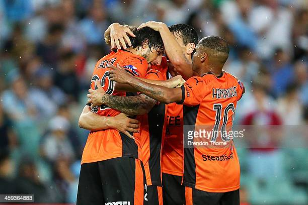 Thomas Broich of the Roar celebrates with team mates after scoring during the round 12 ALeague match between Sydney FC and Brisbane Roar at Allianz...