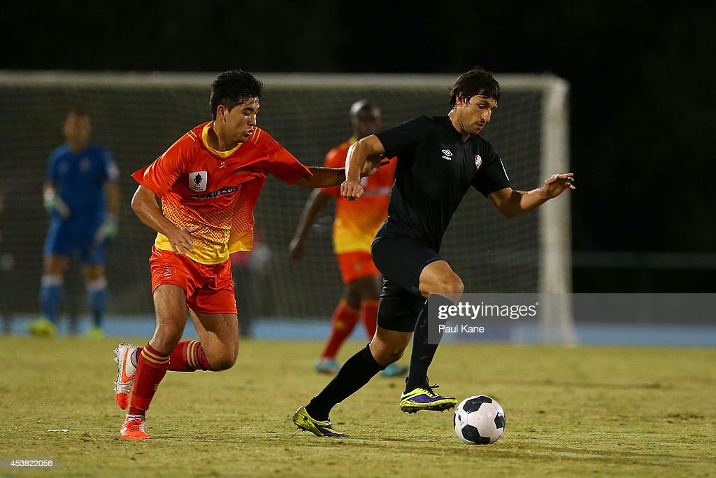 <a gi-track='captionPersonalityLinkClicked' href=/galleries/search?phrase=Thomas+Broich&family=editorial&specificpeople=676225 ng-click='$event.stopPropagation()'>Thomas Broich</a> of the Roar controls the ball against Ali Gholami of the Lion during the FFA Cup match between the Stirling Lions and the Brisbane Roar at Western Australia Athletics Stadium on August 19, 2014 in Perth, Australia.