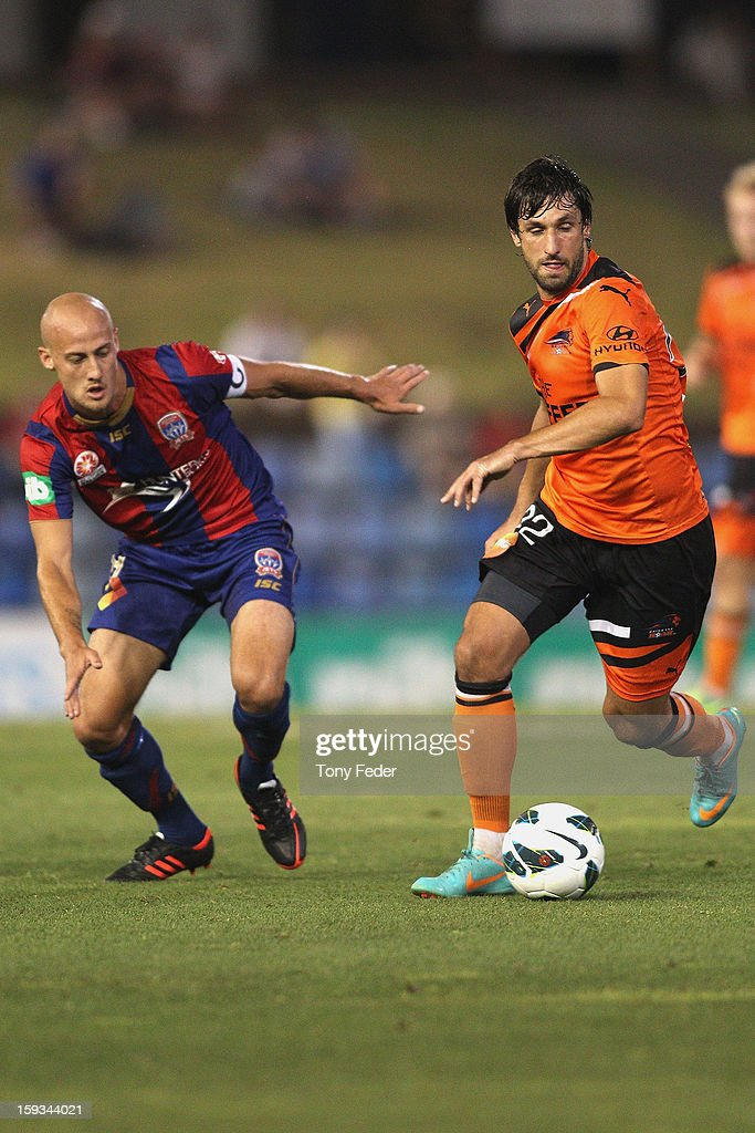 <a gi-track='captionPersonalityLinkClicked' href=/galleries/search?phrase=Thomas+Broich&family=editorial&specificpeople=676225 ng-click='$event.stopPropagation()'>Thomas Broich</a> of the Roar controls the ball in front of Ruben Zadkovich of the Jets during the round 16 A-League match between the Newcastle Jets and the Brisbane Roar at Hunter Stadium on January 12, 2013 in Newcastle, Australia.