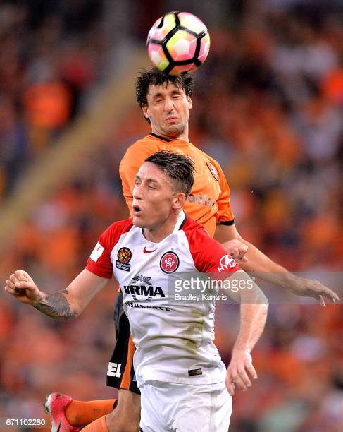 Thomas Broich of the Roar gets above Scott Neville of the Wanderers as the compete for the ball during the ALeague Elimination Final match between...