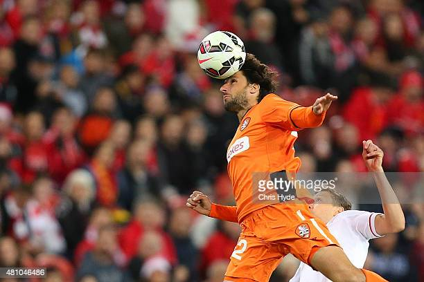 Thomas Broich of the Roar heads the ball during the international friendly match between Brisbane Roar and Liverpool FC at Suncorp Stadium on July 17...