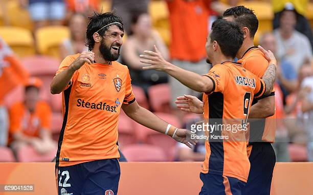 Thomas Broich of the Roar is congratulated by team mates after scoring a goal during the round 10 ALeague match between the Brisbane Roar and...