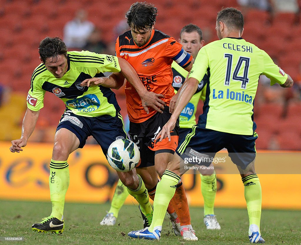 <a gi-track='captionPersonalityLinkClicked' href=/galleries/search?phrase=Thomas+Broich&family=editorial&specificpeople=676225 ng-click='$event.stopPropagation()'>Thomas Broich</a> of the Roar takes on the defence during the round 24 A-League match between the Brisbane Roar and the Melbourne Victory at Suncorp Stadium on March 9, 2013 in Brisbane, Australia.