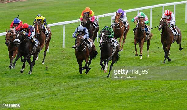Thomas Brown riding Zampa Manos win The Trailfinders The Worldwide Flight Specialists Maiden Stakes at Windsor racecourse on August 12 2013 in...