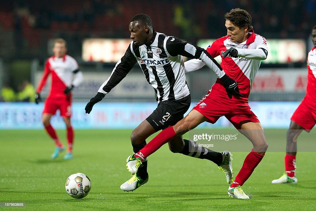 Thomas Bruns of Heracles Almelo, Adam Sarota of FC Utrecht during the Dutch Eredivisie match between Heracles Almelo and FC Utrecht at the Polman Stadium on December 7, 2012 in Almelo, The Netherlands.
