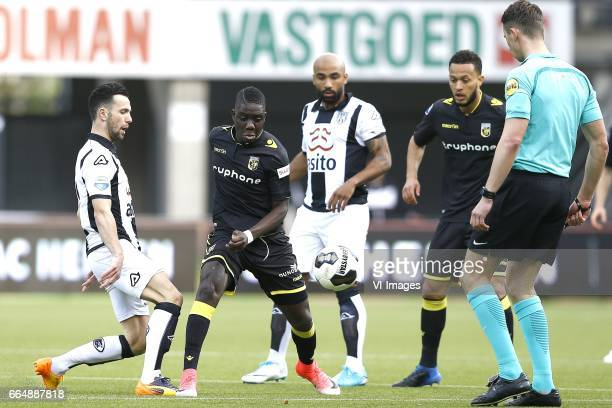 Thomas Bruns of Heracles Almelo Marvelous Nakamba of Vitesse Arnhem Samuel Armenteros of Heracles Almelo Lewis Baker of Vitesse Arnhem referee...