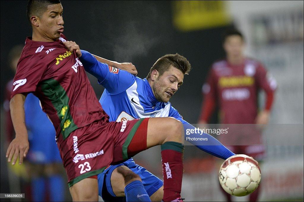 Thomas Buffel of KRC Genk battles for the ball with Hernan Hinostroza of ZulteWaregem during the Cofidis Cup 1/4 final away match between SV Zulte...