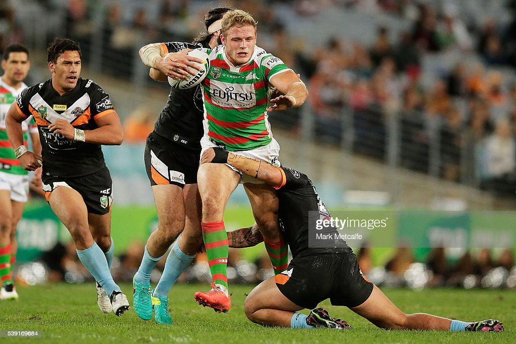 Thomas Burgess of the Rabbitohs is tackled during the round 14 NRL match between the Wests Tigers and the South Sydney Rabbitohs at ANZ Stadium on June 10, 2016 in Sydney, Australia.