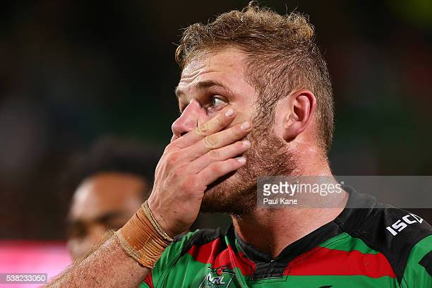 Thomas Burgess of the Rabbitohs reacts after being defeated during the round 13 NRL match between the South Sydney Rabbitohs and the Gold Coast...