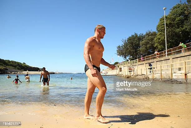 Thomas Burgess walks from the ocean during a South Sydney Rabbitohs NRL recovery session at Clovelly Beach on September 23 2013 in Sydney Australia