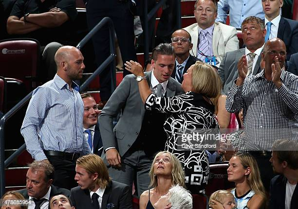 Thomas Chabot is congratulated by family after being selected 18th by the Ottawa Senators during Round One of the 2015 NHL Draft at BBT Center on...