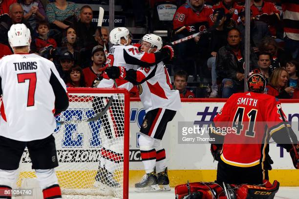 Thomas Chabot Kyle Turris and teammates of the Ottawa Senators celebrate a goal against the Calgary Flames during an NHL game on October 13 2017 at...