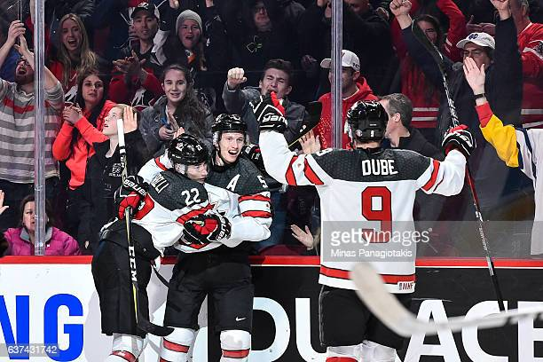 Thomas Chabot of Team Canada celebrates a second period goal with teammates during the 2017 IIHF World Junior Championship quarterfinal game against...