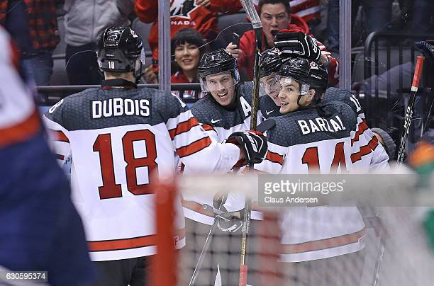 Thomas Chabot of Team Canada celebrates his goal against Team Slovakia during a preliminary game in the 2017 IIHF World Junior Hockey Championship at...