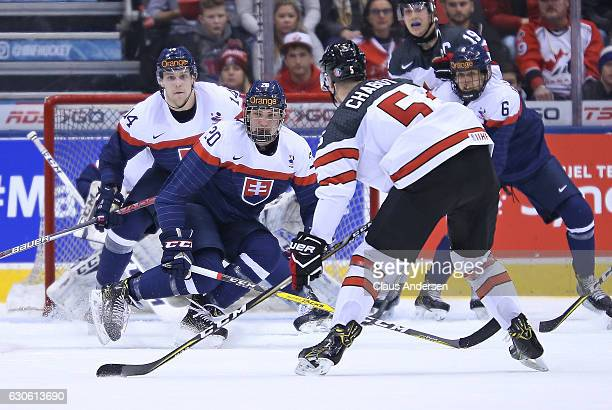 Thomas Chabot of Team Canada gets set to blast a shot past a defending Adam Ruzicka of Team Slovakia during a preliminary game in the 2017 IIHF World...