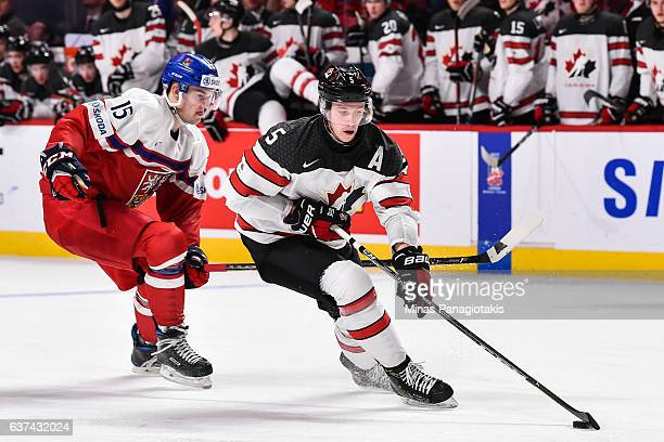 Thomas Chabot of Team Canada skates the puck against Tomas Soustal of Team Czech Republic during the 2017 IIHF World Junior Championship quarterfinal...