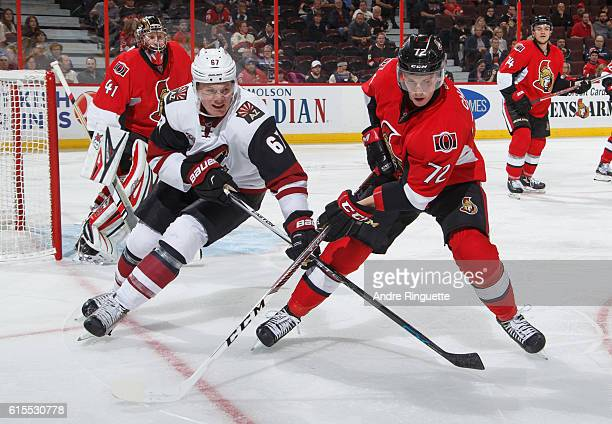 Thomas Chabot of the Ottawa Senators defends against Lawson Crouse of the Arizona Coyotes at Canadian Tire Centre on October 18 2016 in Ottawa...