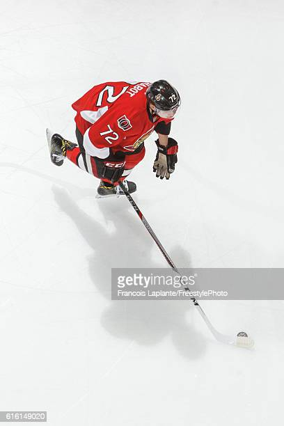 Thomas Chabot of the Ottawa Senators skates with the puck during warmup prior to his first career NHL game against the Arizona Coyotes at Canadian...