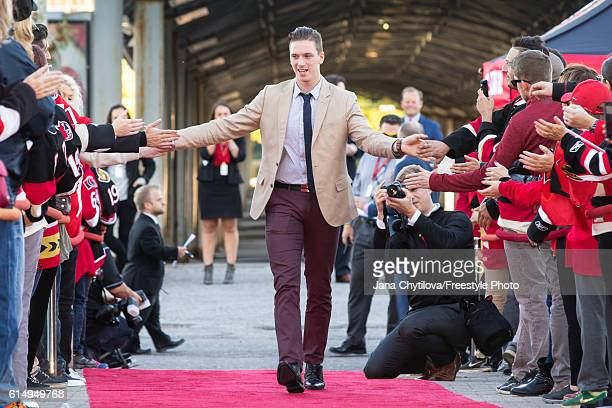 Thomas Chabot of the Ottawa Senators walks the red carpet prior to their home opener against the Toronto Maple Leafs at Canadian Tire Centre on...