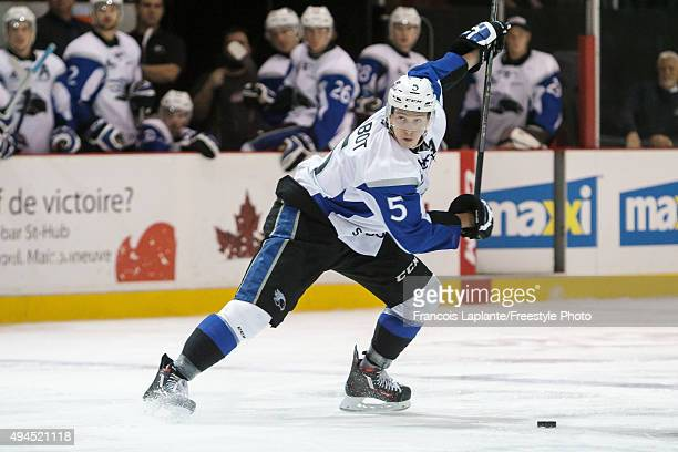 Thomas Chabot of the Saint John Sea Dogs fires a shot against the Gatineau Olympiques on October 18 2015 at Robert Guertin Arena in Gatineau Quebec...