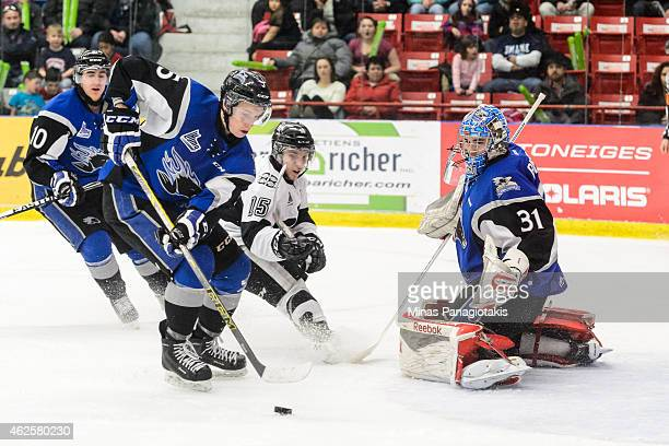 Thomas Chabot of the Saint John Sea Dogs takes control of a rebound left by goaltender Alexander Bishop the QMJHL game at the Centre Excellence...