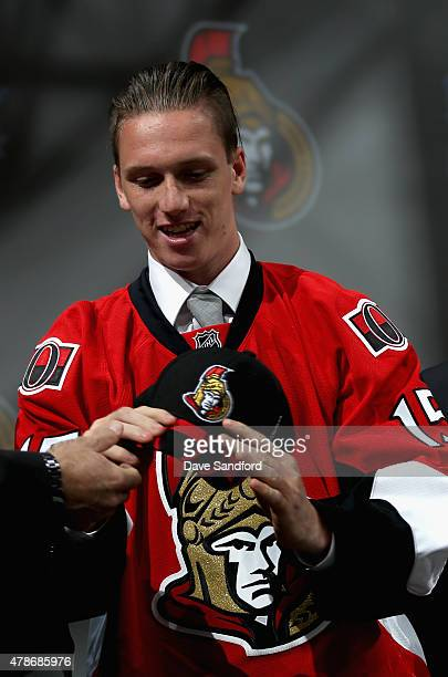 Thomas Chabot puts on his hat after being selected 18th by the Ottawa Senators during Round One of the 2015 NHL Draft at BBT Center on June 26 2015...