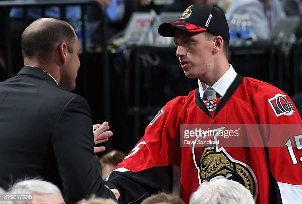 Thomas Chabot shakes the hand of a member of the Ottawa Senators organization after being selected 18th overall by the Ottawa Senators during Round...