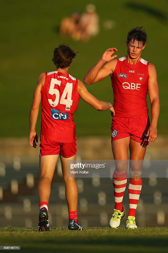 Thomas Chichester of the Red Team celebrates a goal with Callum Sinclair of the Red Team during the Sydney Swans AFL intra-club match at Henson Park on February 12, 2016 in Sydney, Australia.