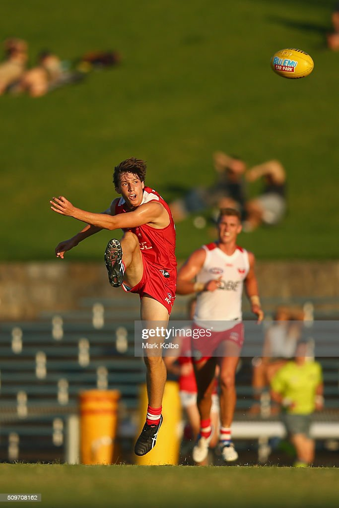 Thomas Chichester of the Red Team kicks a goal during the Sydney Swans AFL intra-club match at Henson Park on February 12, 2016 in Sydney, Australia.