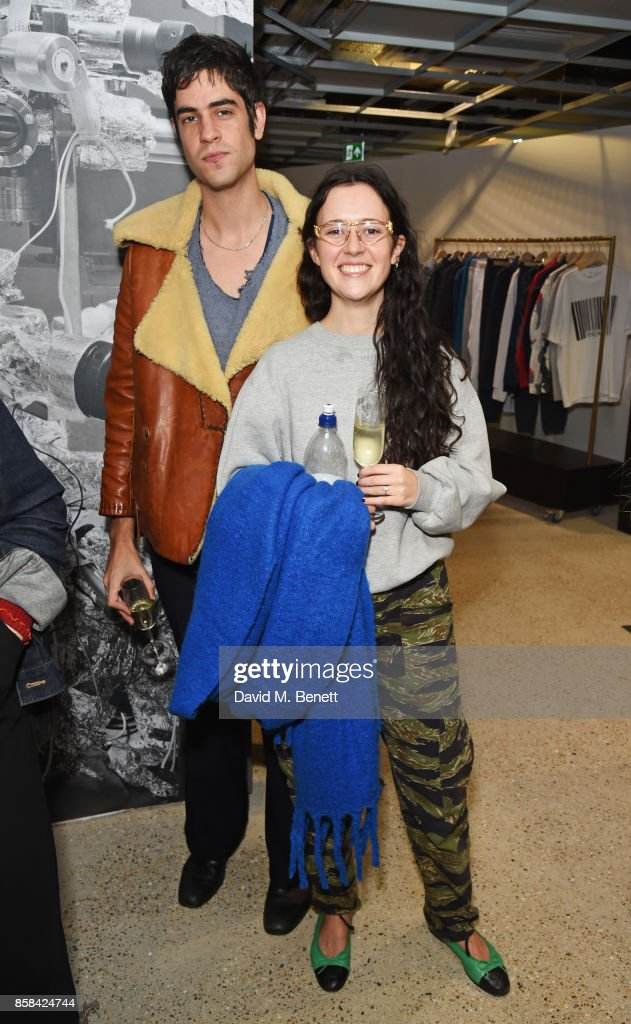 Thomas Cohen (L) and Ashley Williams attend the Dover Street Market open house on October 6, 2017 in London, England.