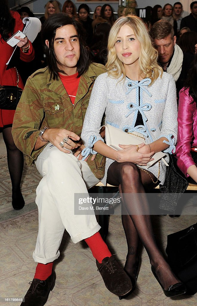 Thomas Cohen (L) and Peaches Geldof attend the Moschino cheap&chic show during London Fashion Week Fall/Winter 2013/14 at The Savoy Hotel on February 16, 2013 in London, England.