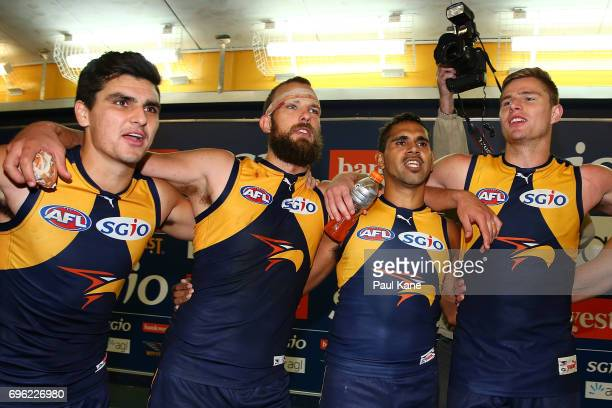 Thomas Cole Will Schofield Lewis Jetta and Nathan Vardy of the Eagles sing the club song after winning the round 13 AFL match between the West Coast...