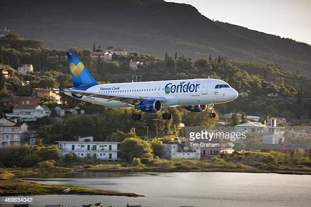 Thomas Cook Condor jet airplane tourist charter flight pilot flying into Kerkyra Corfu Town ready for landing Ionian Islands Greece