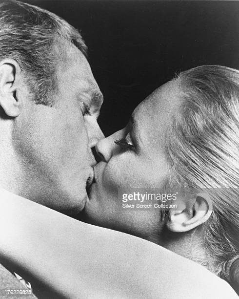 Thomas Crown played by American actor Steve McQueen kisses Vicki Anderson played by Faye Dunaway in 'The Thomas Crown Affair' directed by Norman...