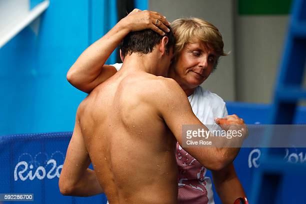 Thomas Daley of Great Britain hugs his coach Jane Figueiredo after competing in the Men's Diving 10m Platform semifinal on Day 15 of the Rio 2016...