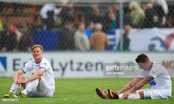Thomas Dalgaard and Tiago de Leonco of Vendsyssel FF looks dejected after the Danish Alka Superliga Playoff match between Vendsyssel FF and AC...