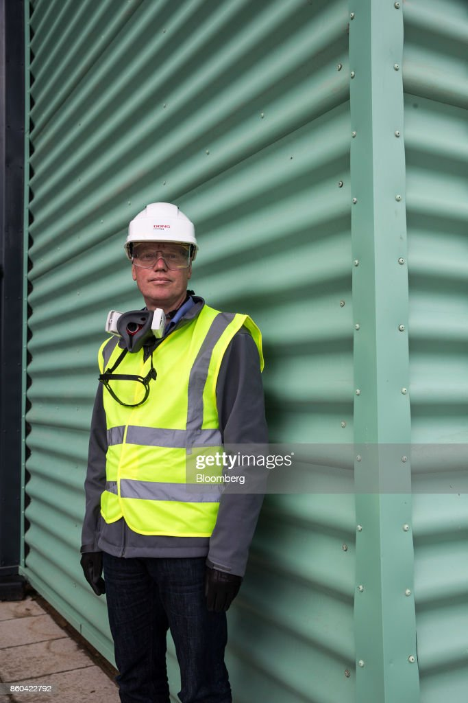 Thomas Dalsgaard, executive vice president of thermal power and bioenergy at Dong Energy A/S, stands at the Renesciencewaste energy plant,operated by Dong Energy A/S, in Northwich, U.K., on Thursday, Oct. 5, 2017. The Renescience process starts with a giant claw that crunches into a mountain of trash and it ends with seven different types of materialfrom plastics to metals and biogas, that can be used to create electricity, recycled or sold on to a scrap yard. Nothing goes to landfill. Photographer: Matthew Lloyd/Bloomberg via Getty Images