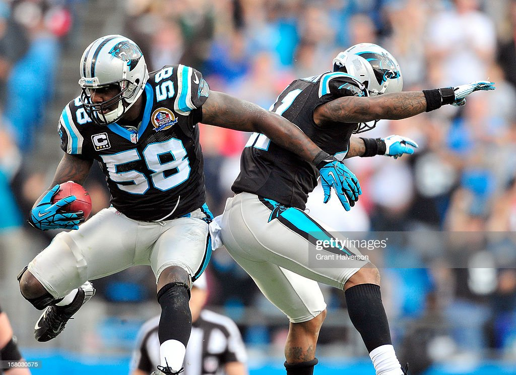 Thomas Davis #58 and Captain Munnerlyn #41 of the Carolina Panthers celebrate after Davis's interception of Matt Ryan #2 of the Atlanta Falcons during play at Bank of America Stadium on December 9, 2012 in Charlotte, North Carolina. Carolina defeated Atlanta, 30-20.