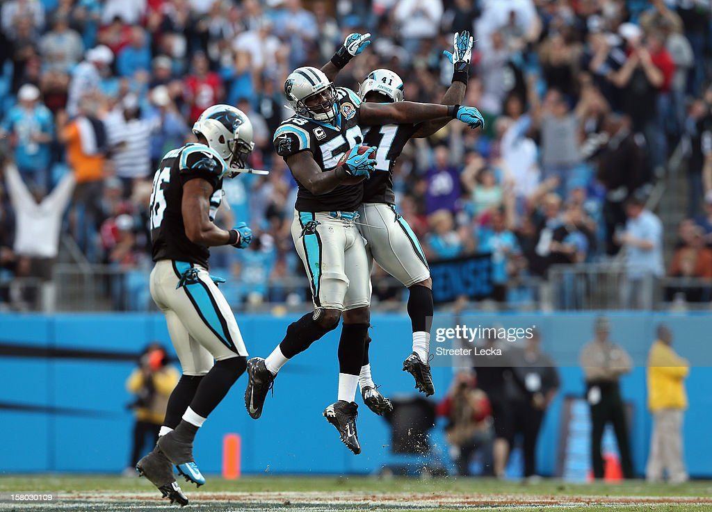 Thomas Davis #58 of the Carolina Panthers celebrates after making an interception against the Atlanta Falcons during their game at Bank of America Stadium on December 9, 2012 in Charlotte, North Carolina.