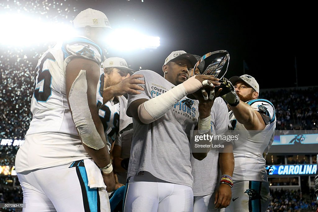 Thomas Davis of the Carolina Panthers celebrates with the George Halas Trophy after defeating the Arizona Cardinals with a score of 49 to 15 to win...