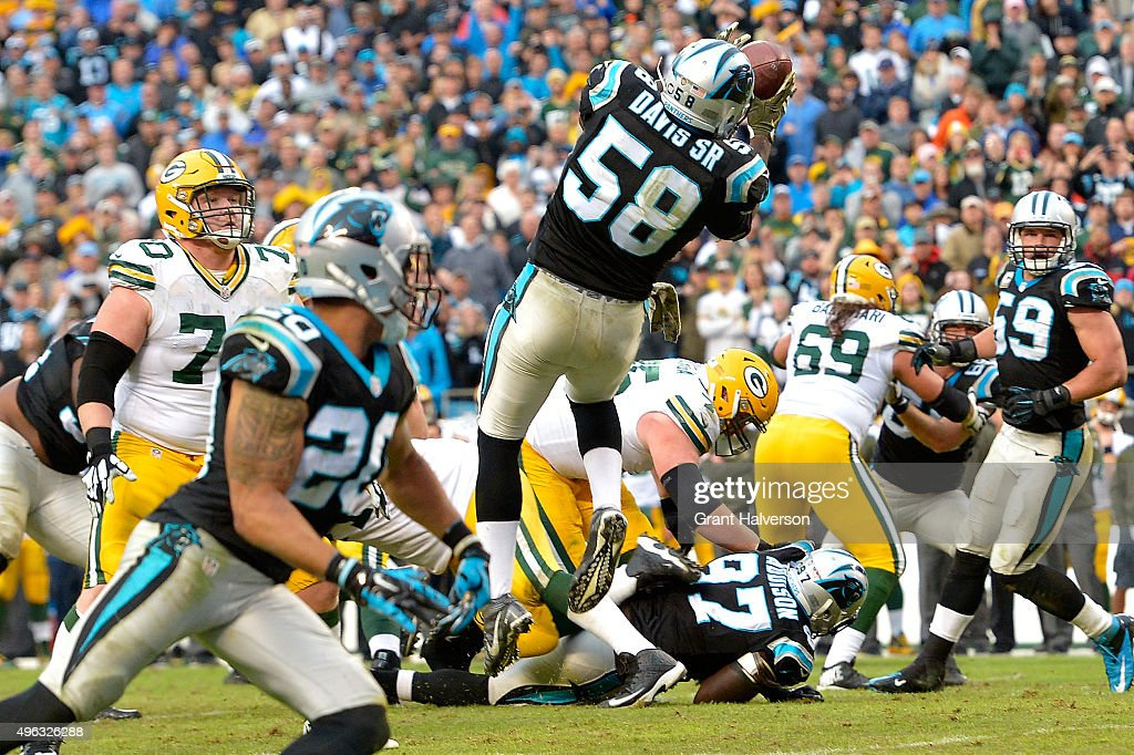 Thomas Davis of the Carolina Panthers intercepts Aaron Rodgers of the Green Bay Packers on fourth down late in the fourth quarter of their game at...