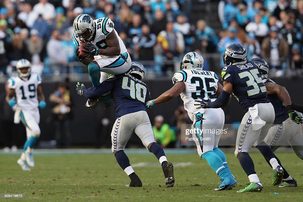 Thomas Davis of the Carolina Panthers recovers an onside kick against the Seattle Seahawks in the 4th quarter during the NFC Divisional Playoff Game...