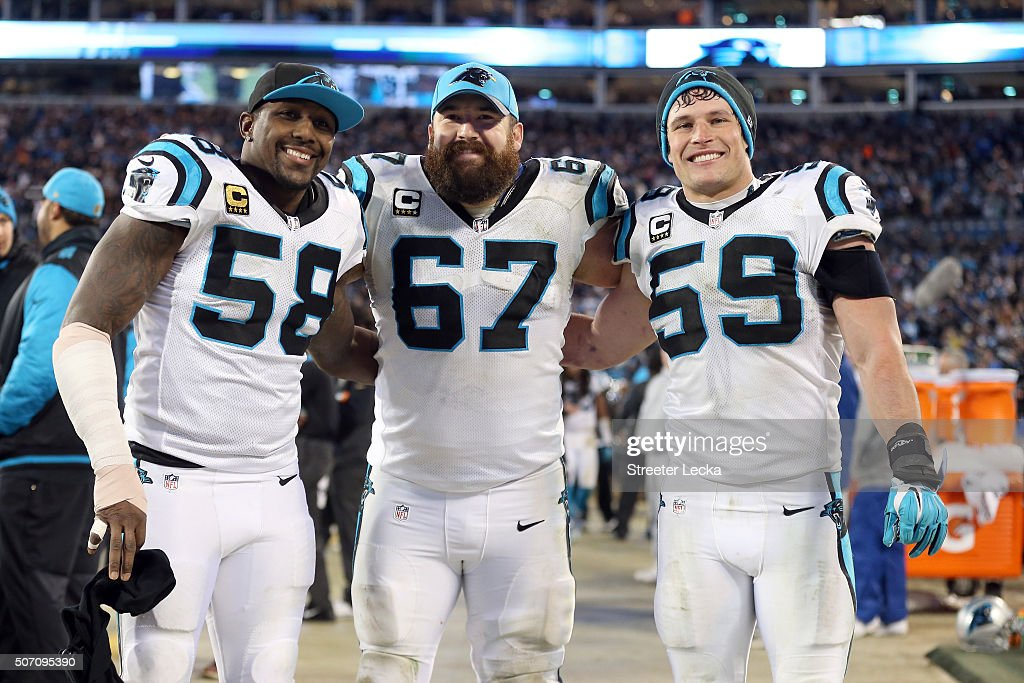 Thomas Davis Ryan Kalil and Luke Kuechly of the Carolina Panthers pose on the sidelines during the NFC Championship Game against the Arizona...
